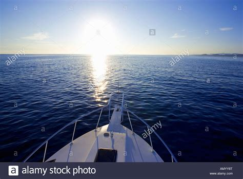 facing the bow of a boat where is the port side bow of sport fishing boat yacht facing into sunrise