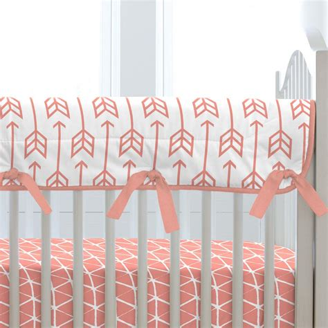 crib cover to block light light coral arrow crib rail cover carousel designs