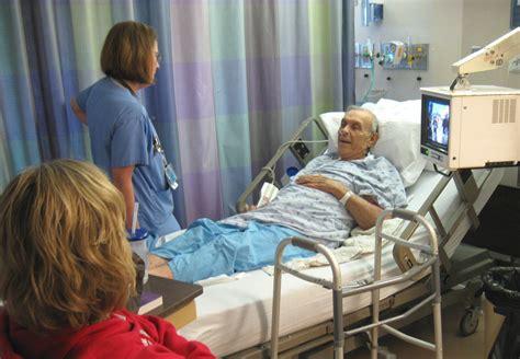 person in hospital bed person in hospital bed with family