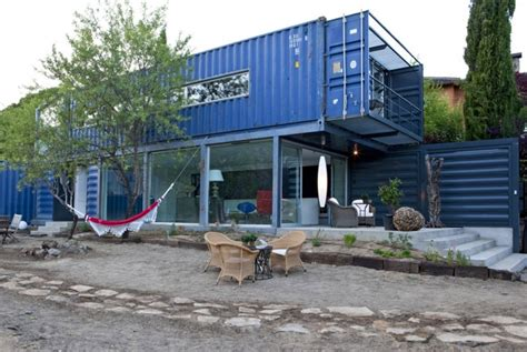 mau builds a modern blue home from four shipping
