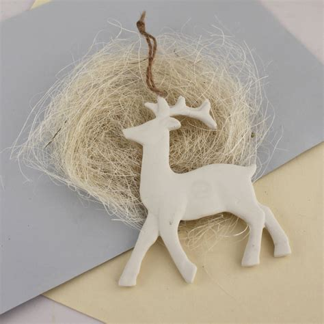 pair of white ceramic reindeer by posh totty designs