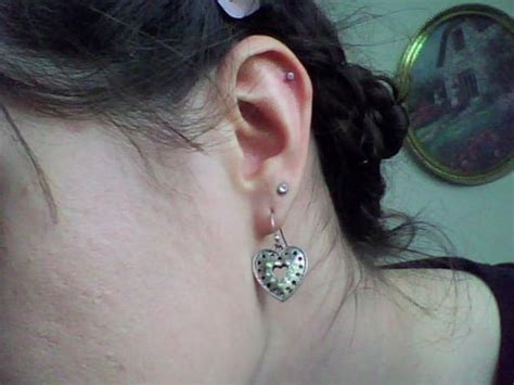 tattoo parlor ear piercing near me upper ear cartilage piercing by chris kane at above all
