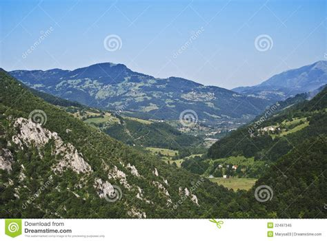 sunny day in the mountains a mountain of the alps switzerland before green mountains in a sunny day royalty free stock photo