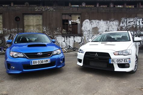 subaru mitsubishi the big debate subaru wrx sti or mitsubishi lancer