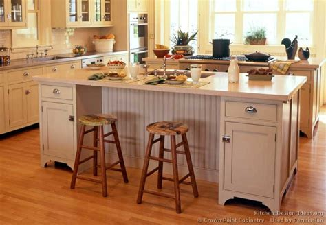 kitchen island with cabinets and seating pictures of kitchens traditional white antique