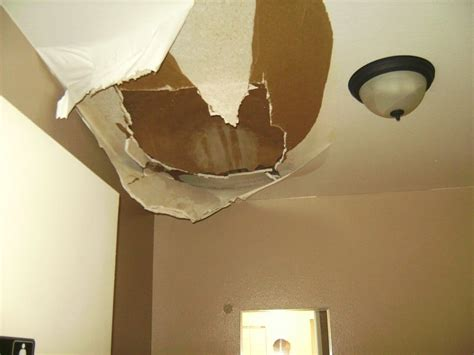 ceiling leak from upstairs bathroom yikes ceiling is falling down there was a water leak