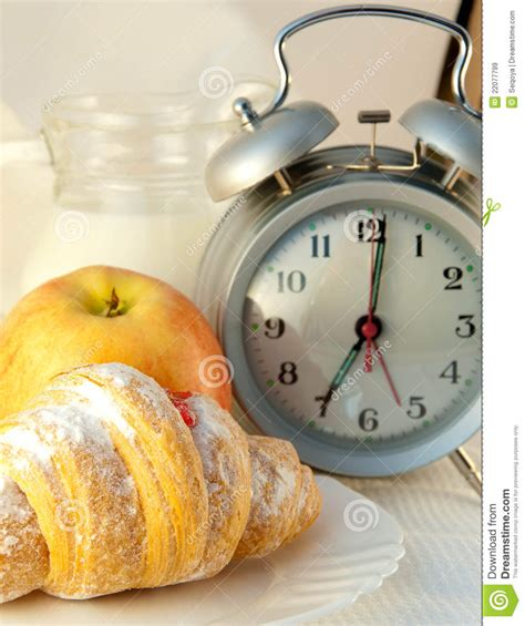 Alarm Jam croissant with jam and a jug of milk and an alarm royalty