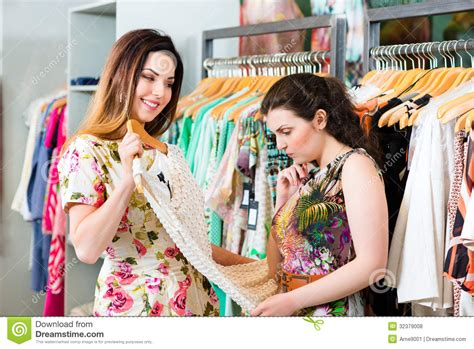 women clothes store beauty clothes young women shopping fashion in department store royalty