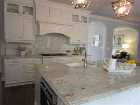 white kitchen wood floors marble backsplash