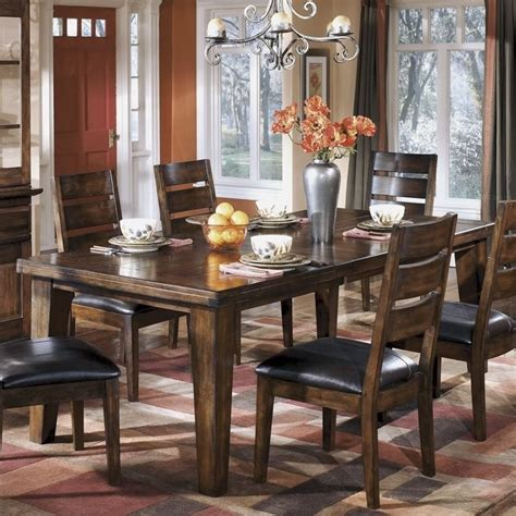 brown dining room table discounted ashley larchmont wood extendable dining room