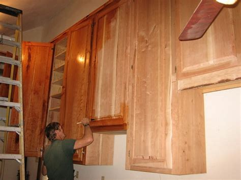 refinish wood cabinets by painting preparing for the process