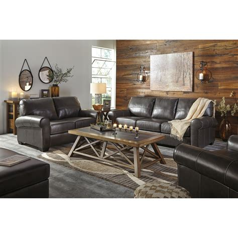 Virginia Furniture Market by Benchcraft Canterelli Leather Match Sofa With Rolled Arms