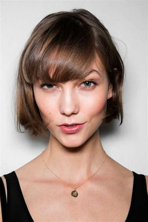 swoop bangs with short curly hair short wavy hairstyle with side swept bangs elizabeth