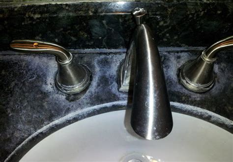 how to remove hard water stains from granite composite sink how to remove water stains from quartz countertops