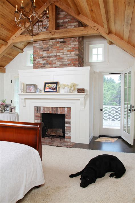 white bedroom with traditional fireplace white bedroom brick fireplace bedroom farmhouse with cathedral ceiling