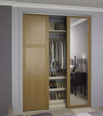 Howdens Fitted Wardrobes by Oak Shaker Panel Mirror Door Sliding Wardrobe Doors