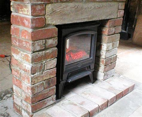 Traditional Brick Fireplace by Emblaze With A Unique Fireplace