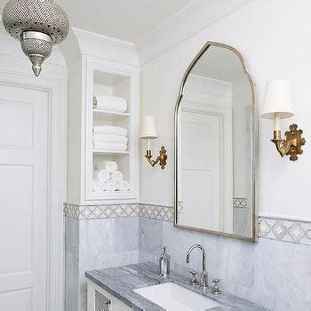 white and gold arabesque tiles transitional bathroom