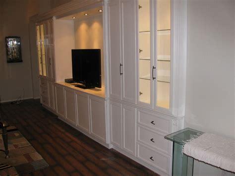 white entertainment wall unit traditional family room miami     furnitures