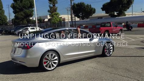 tesla outside tesla model 3 prototype in the outside unplugged
