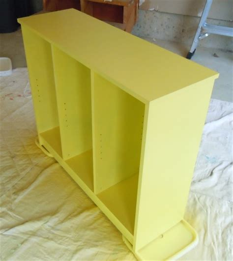 spray paint bookshelf painting a laminate bookshelf