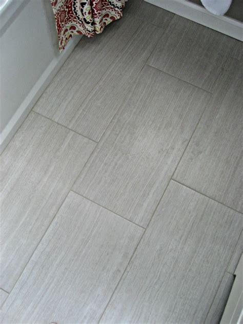 wood tiles transitional bathroom involving color