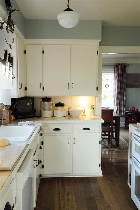 how to paint kitchen cabinet hardware we have an old new england cottage with lots of knotty pine cabinets walls and ceiling