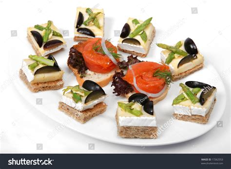 a plate of brie cheese on toast canapes and smoked salmon