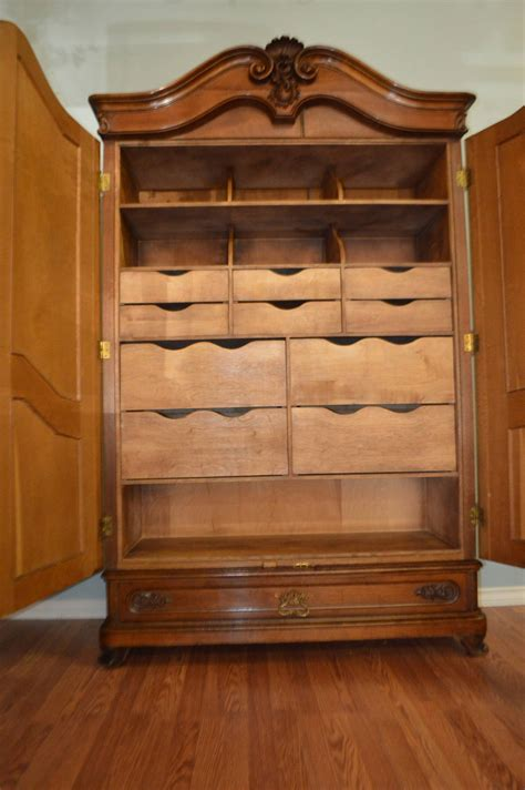 19th century walnut armoire with custom built in drawers