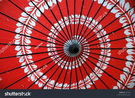 spiral pattern umbrella red japanese umbrella spiral floral design stock photo