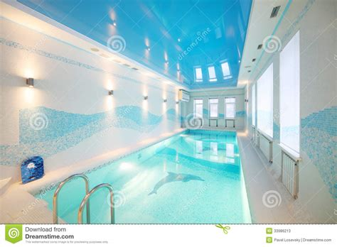 indoor pool with images of dolphins at bottom and clear