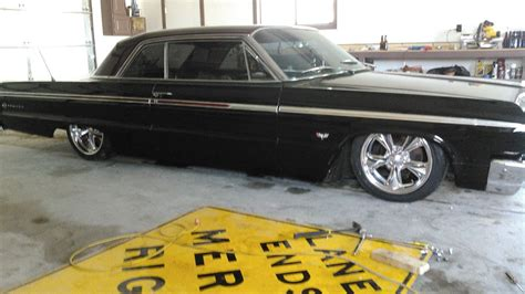 1964 chevy impala with 20 quot ridler 695 wheels