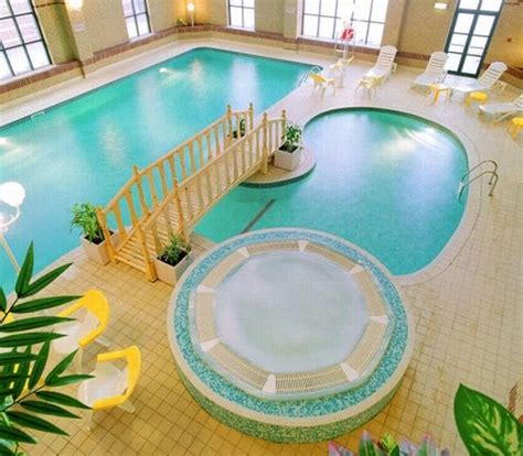 12 posh designs of indoor pools inside luxury homes hometone