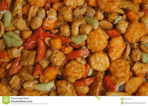 Crunchy And Tasty Salty Snacks by Snacks Background With Salty Crunchy Treats Royalty Free