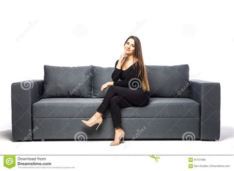 handson sofa woman sitting with hands on chin on sofa on white
