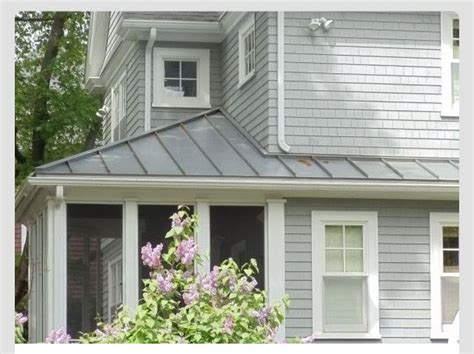 light grey house charcoal metal roof white trim this is the one i like the best house