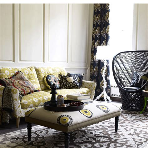 Mixed Prints And Patterns Make This Living Room So Boho   twine mixing patterns