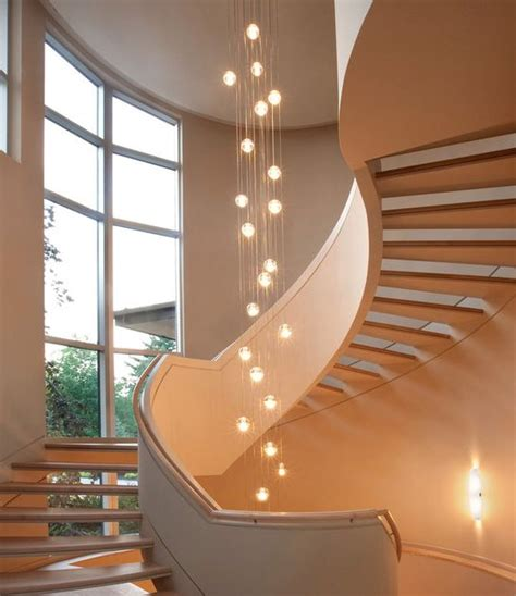Staircase Lighting Ideas Use Large Globe Light Bulbs To Make A Statement In Stairway Ceiling Fixtures Stairlighting