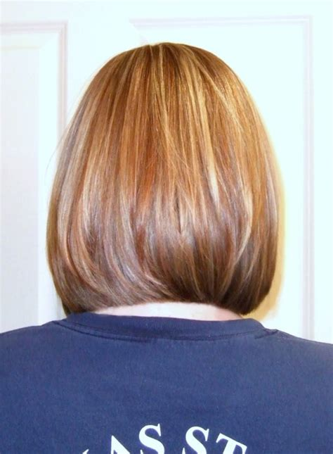 bobs with slight stack mid length bob with long layers and slight face frame