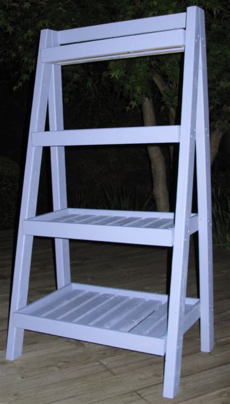 diy ladder shelves white gardener s ladder shelf diy projects