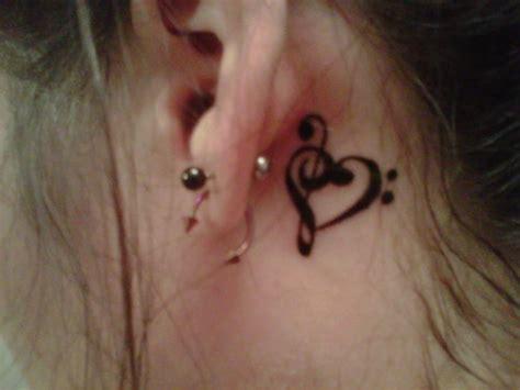 dot tattoo behind ear bass treble clef heart tattoo new tattoo ideas