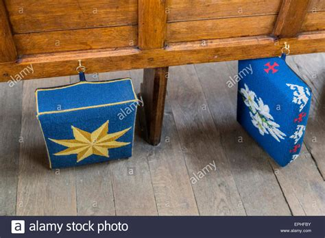 Good Church Kneeler Cushions #2: Embroidered-kneelers-hassocks-or-prayer-cushions-attached-to-a-pew-EPHFBY.jpg