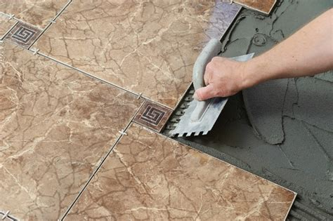Cost To Install Tile Flooring by Laying The Tiles Builders Floors Interiorsbuilders