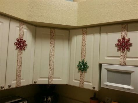 christmas bows on kitchen cabinets spread holiday cheer with your kitchen cabinets