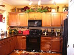 above kitchen cabinet decor ideas pin by terrie krupitzer on decorating the top of kitchen
