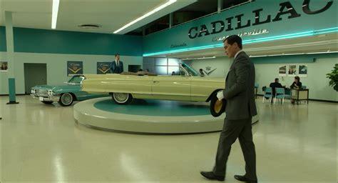 cadillac car dealership   shape  water
