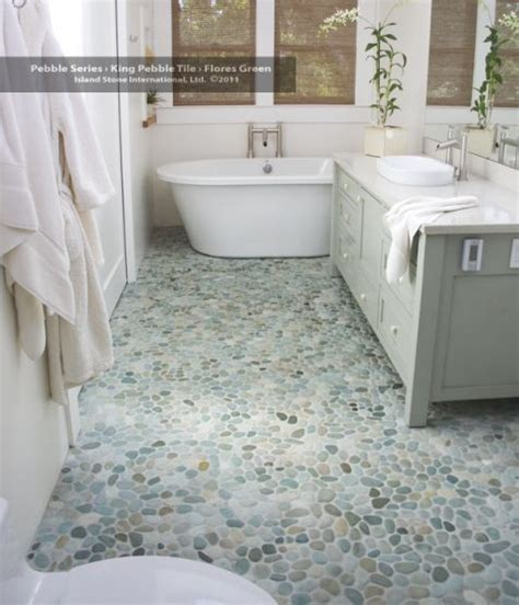 inexpensive bathroom flooring 25 best ideas about river rock shower on
