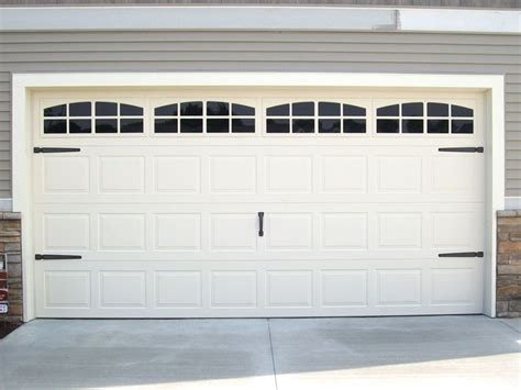 Dress Up Your Garage Door by Carriage House Door Hardware And Faux Windows To Dress Up