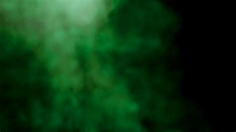 green cocktail black background smoke colorful green on black background abstract smoke