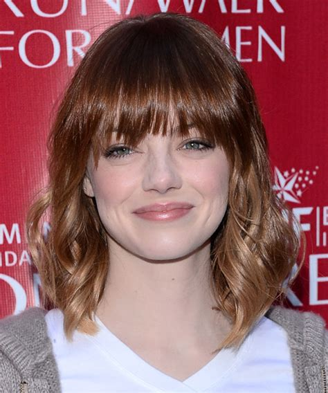 casual updos round faces emma stone medium wavy casual hairstyle with layered bangs